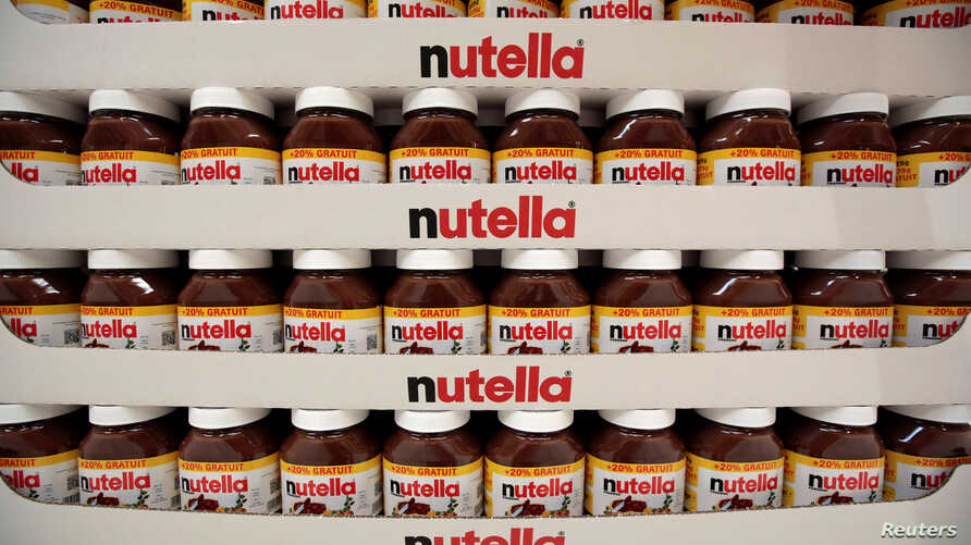 FILE - Jars of Nutella chocolate hazelnut paste are displayed in France, April 6, 2016.