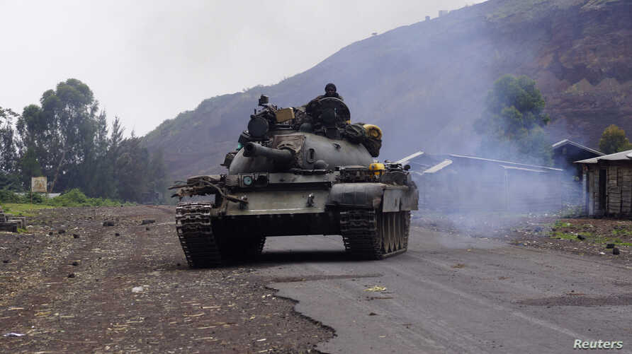A Congolese government military tank patrols in Kanyarucinya village in the outskirts of Goma in the eastern Democratic Republic of Congo, August 22, 2013.