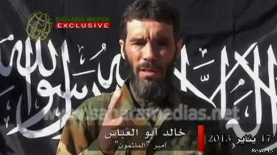 FILE - Wanted terrorist Mokhtar Belmokhtar speaks in this undated still image taken from video released by Sahara Media, Jan. 21, 2013.