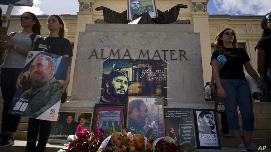 People with images of Fidel Castro gather one day after his death in Havana, Cuba, Nov. 26, 2016. Cuba will observe nine days of mourning for the former president.