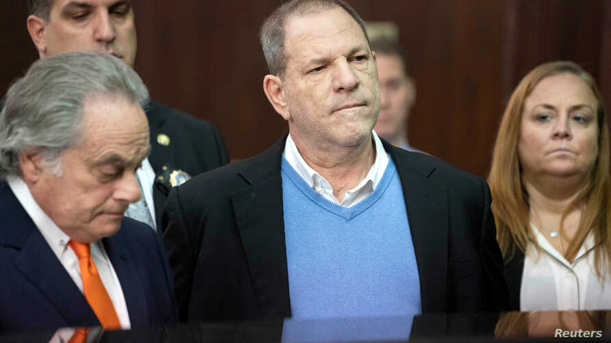 FILE - Film producer Harvey Weinstein stands with his lawyer, Benjamin Brafman, left, inside Manhattan Criminal Court during his arraignment in Manhattan, New York, May 25, 2018.
