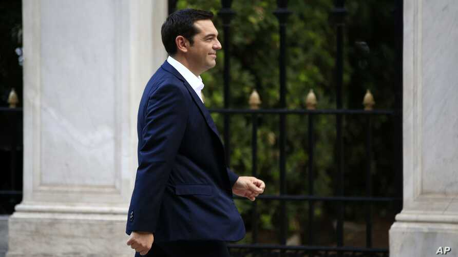 The leader of Greece's Syriza party Alexis Tsipras arrives at the Presidential Palace in Athens, Sept. 21, 2015.