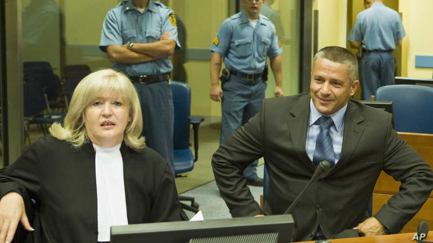 FILE- Naser Oric (R) is seen with his lawyer during his trial in The Hague, Netherlands, July 3, 2008.