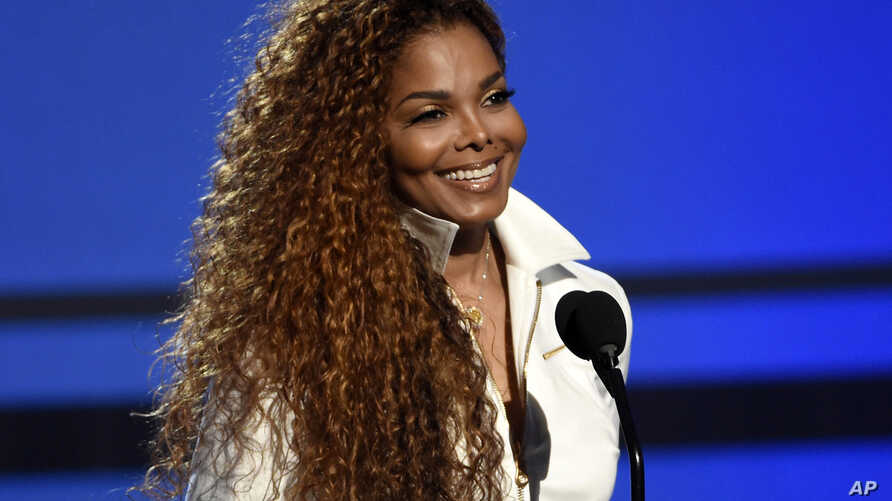 FILE - Janet Jackson accepts the ultimate icon: music dance visual award at the BET Awards in Los Angeles.