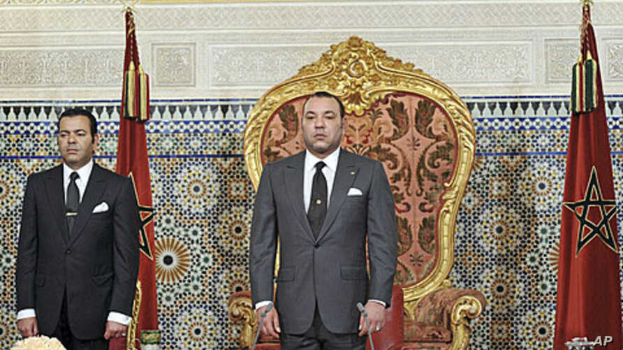 Morocco's King Mohammed (R), shown here as he prepared to address the nation on June 17, 2011, is under pressure to guarantee a greater separation of power in the kingdom
