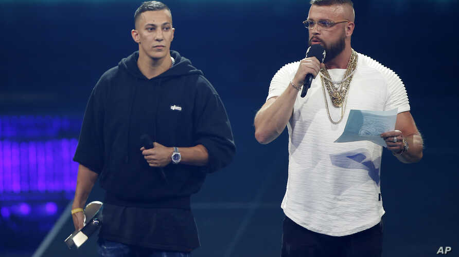 "German rappers Kollegah & Farid Bang receive the ""Hip-Hop/Urban national"" award during the 2018 Echo Music Awards ceremony in Berlin, April 12, 2018."