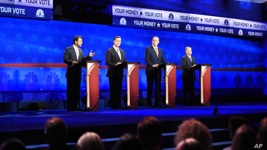 Republican presidential candidates, from left: Bobby Jindal, Rick Santorum, George Pataki, and Lindsey Graham take the stage during the CNBC Republican presidential debate at the University of Colorado, Oct. 28, 2015.