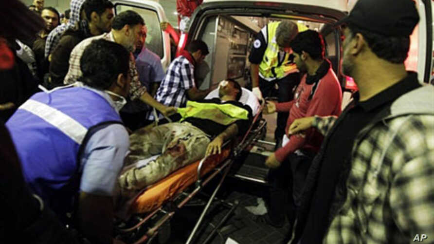 A wounded Shi'ite Bahraini demonstrator is taken to a hospital in Manama after being assaulted by riot police on February 17, 2011