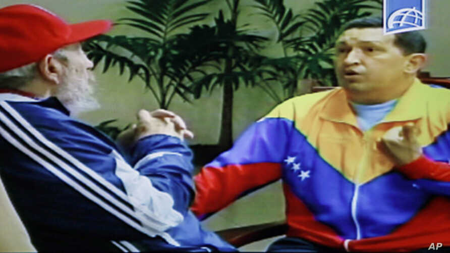 Image from video shown on Cuban state television shows Cuba's Fidel Castro, (l) speaking with Venezuela's President Hugo Chavez in an unknown location in Havana, June 28, 2011