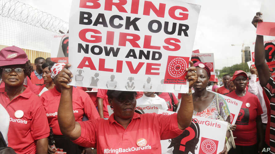Bring back our girls campaigners chant slogans during a protest calling on the government to rescue the remaining kidnapped girls of the government secondary school who were abducted almost three years ago, in Lagos, Nigeria, April. 13, 2017.