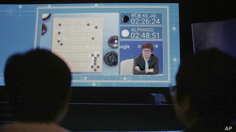 Spectators watch a video screen as Go player Ke Jie plays a match against Google's artificial intelligence program, AlphaGo, during the Future of Go Summit in Wuzhen in eastern China's Zhejiang Province, May 23, 2017.