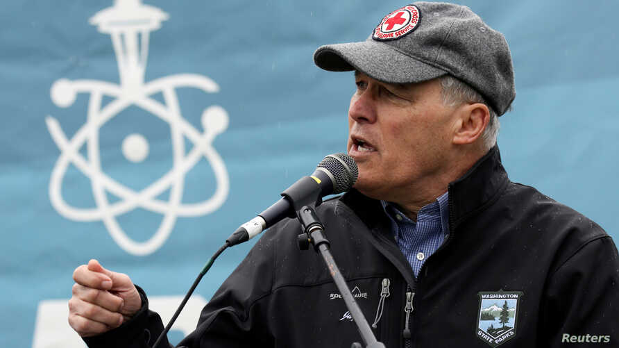 FILE - Washington Gov. Jay Inslee speaks during a rally at the beginning of the March For Science in Seattle, Washington, April 22, 2017.