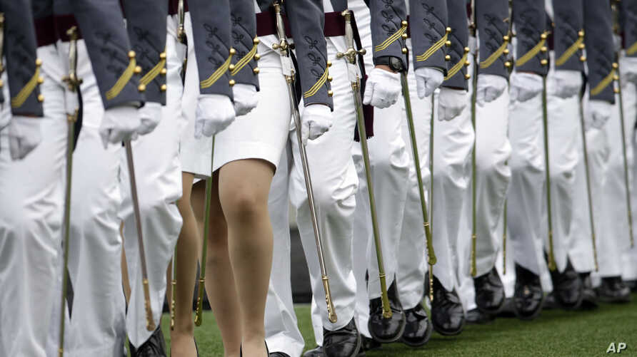 FILE - Graduating cadets march during a graduation and commissioning ceremony at the U.S. Military Academy in West Point, New York, May 21, 2016. In a reversal, West Point has seen a spike in sexual assualt reports last year.