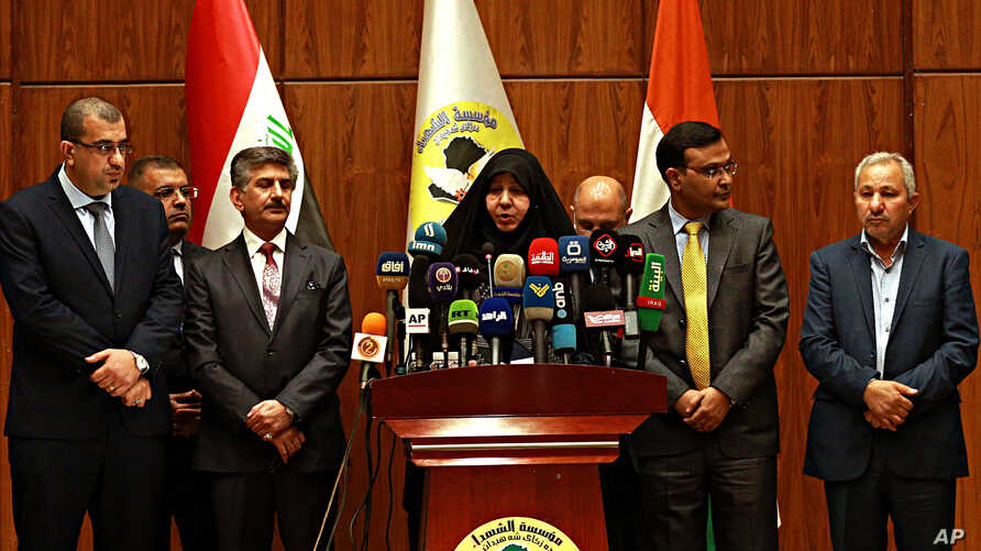 Najiha Abdul-Amir al-Shimari, head of Iraq's Martyrs Establishment speaks during a press conference, in Baghdad, March 20, 2018. Al-Shimari said the bodies of 38 of 39 Indians abducted by the Islamic State group were found in a mass grave outside Mos
