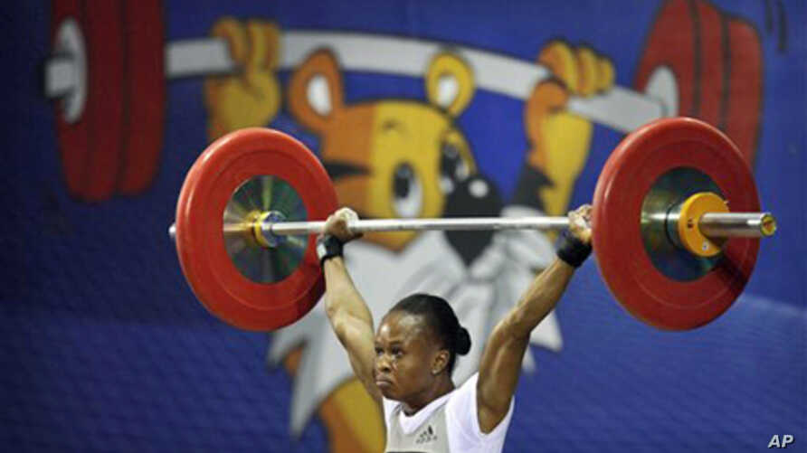 Nigeria's Augustina Nwaokolo wins a Gold medal in the women's weightlifting event at the Commonwealth Games in New Delhi, India, 4 Oct. 2010