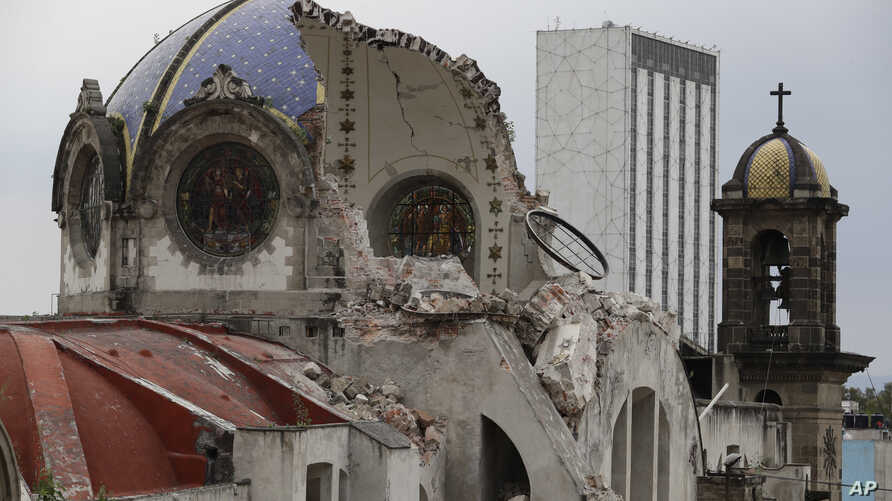 The damaged dome of Our Lady of Angels Church, which collapsed Sunday afternoon, is seen from an adjacent rooftop in the Guerrero neighborhood of Mexico City, Sept. 24, 2017.