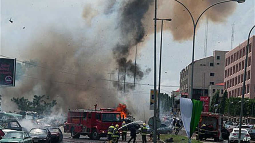 Smoke and debris fill the sky seconds after a car bomb explodes alongside firemen responding to an initial car bomb that had exploded five minutes earlier, in Abuja, Nigeria, 01 Oct 2010
