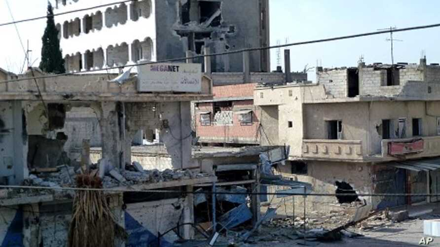 Handout photo released by the Syrian opposition Shaam News Network on April 25, 2012, shows a shop destroyed during a Syrian government offensive in the city of Duma.