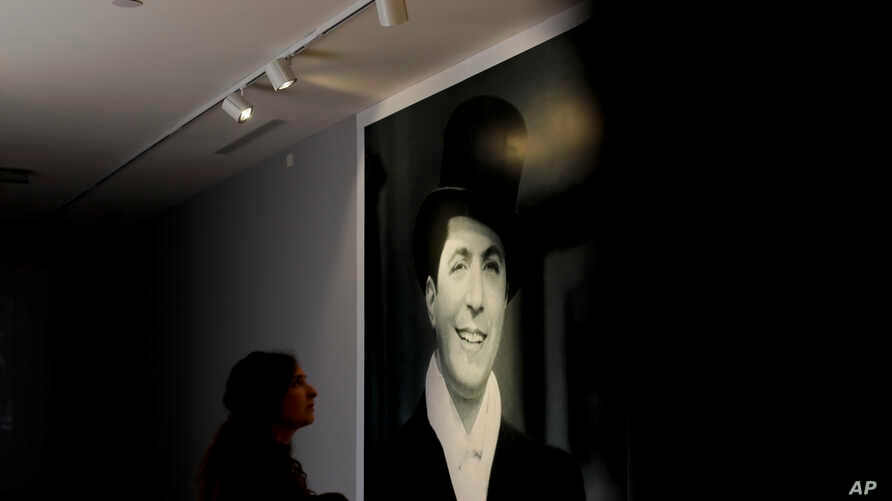 A woman looks at a picture of Carlos Gardel at his museum in Buenos Aires, Argentina, July 5, 2017.