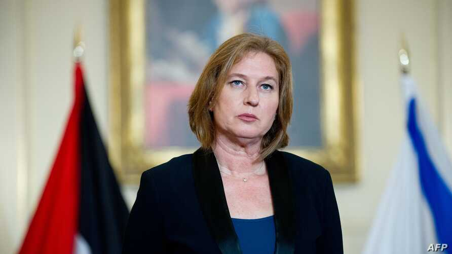 Israel's chief negotiator and Justice Minister Tzipi Livni listens to US Secretary of State John Kerry speak to the press with chief Palestinian negotiator Saeb Erakat at the State Department in Washington, D.C., July 30, 2013.