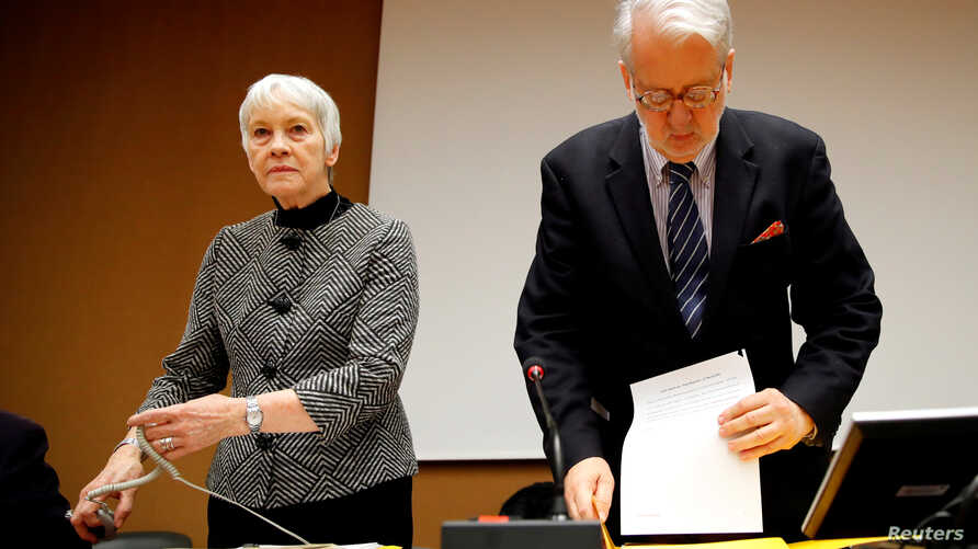 FILE -  Paulo Pinheiro, Chairperson of the Commission of Inquiry on Syria, arrives with Karen Abuzayd, member of the Commission before the launch of their report on sexual and gender-based violence in Syria at the United Nations office in Geneva, Swi