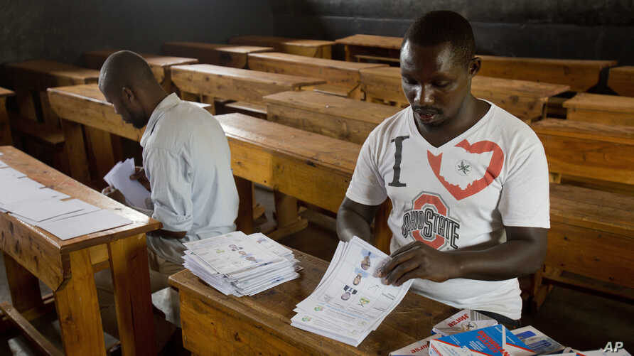 Election volunteers count ballots at a polling station in Rwanda's capital Kigali Aug. 3, 2017, in preparation for the presidential election on Friday.