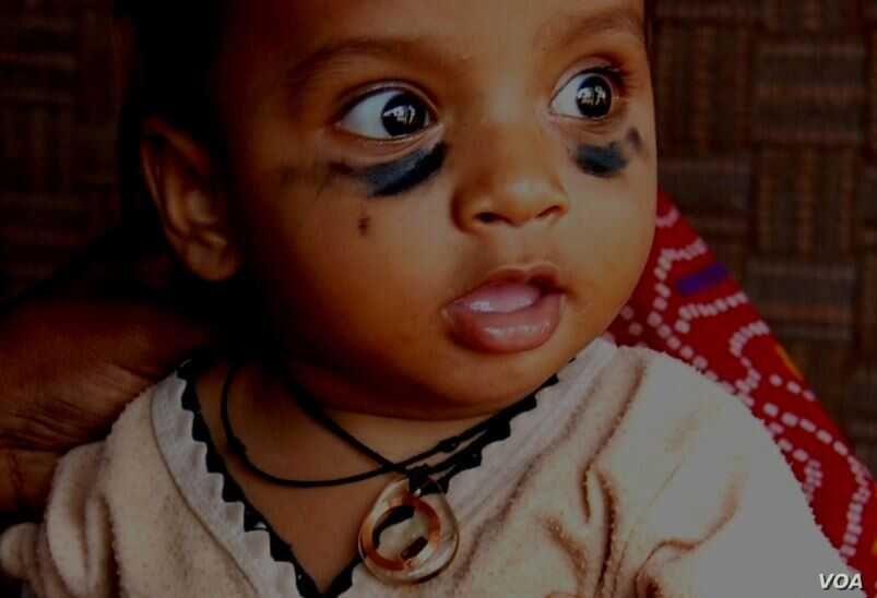 """The """"Khushi baby"""" necklace contains a personal two-year immunization record for children that can be read by a smartphone."""