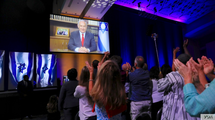 Israeli Prime Minister Benjamin Netanyahu addresses a conference of Christians United for Israel via video link, in Washington, D.C., July 23, 2018.