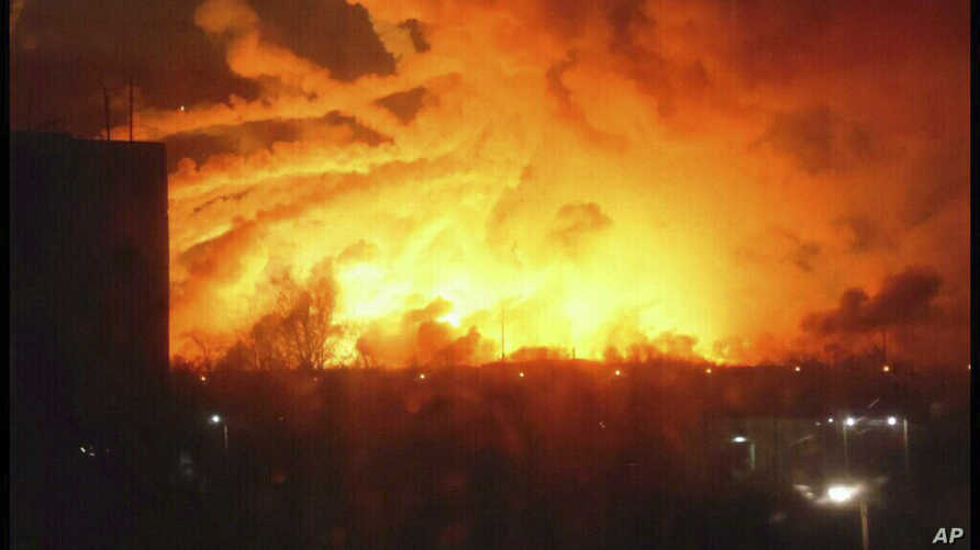This photo provided by Ukrainian Emergency Situations Ministry press service shows a fire raging at a military ammunition depot in Balaklia near Khrakiv in Ukraine, March 23 2017.