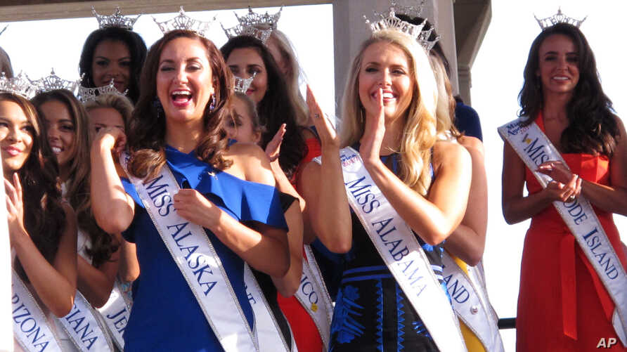 FILE - Contestants attend a welcoming ceremony for the Miss America competition in Atlantic City, N.J., Aug. 30, 2017. On May 17, 2018, the Miss America Organization announced it has installed women in the organization's three top leadership posts fo