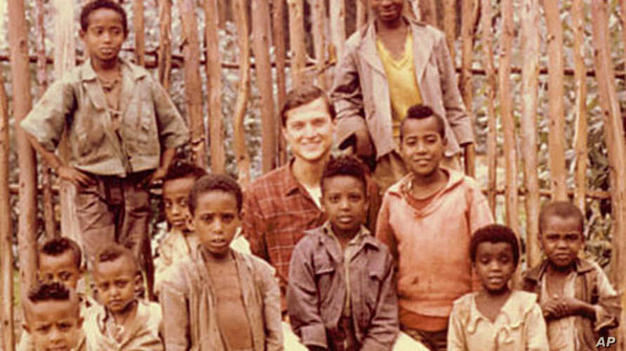 Michael MicCaskey surrounded by children from the town of Fetche, Ethiopia where he served in the Peace Corps (1965)