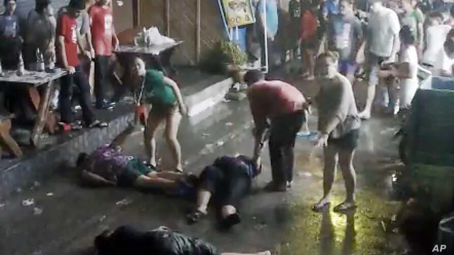 Image taken from video released by the Hua Hin Municipality an elderly British couple and their son are on the ground after they were savagely attacked during a family vacation in Hua, Hin, Thailand, April 13, 2016.