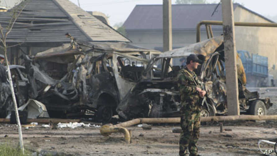 A police officer guards the site of a powerful explosion on the outskirts of Makhachkala, Dagestan, May 4, 2012.