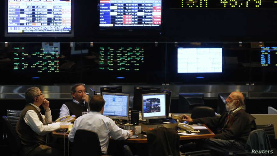 Argentine stockbrokers work on the floor of the Buenos Aires Stock Exchange Monday. The U.S. Supreme Court declined to hear Argentina's appeal over its battle with hedge funds that refused to take part in its debt restructurings, June 16, 2014.