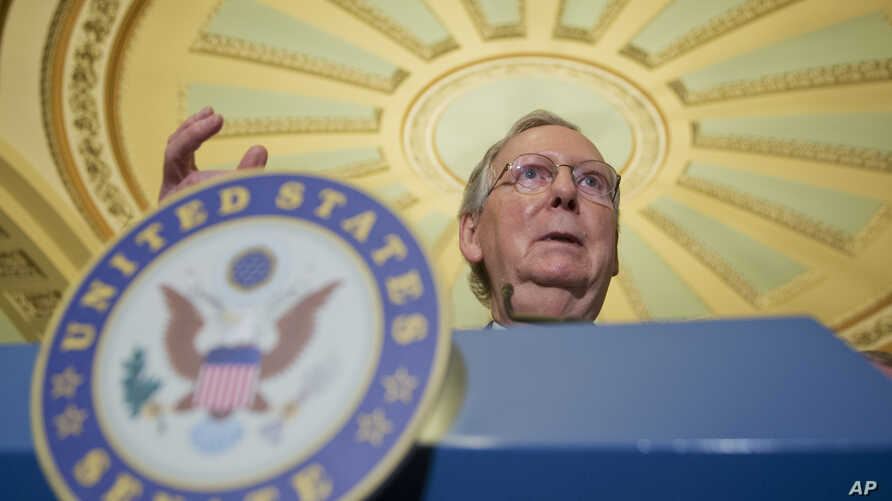 FILE - Senate Majority Leader Mitch McConnell of Kentucky speaks during a news conference on Capitol Hill in Washington, July 12, 2016. In the wake of the Florida school shooting on Feb. 14, 2018, McConnell so far has held back on bringing to the flo...