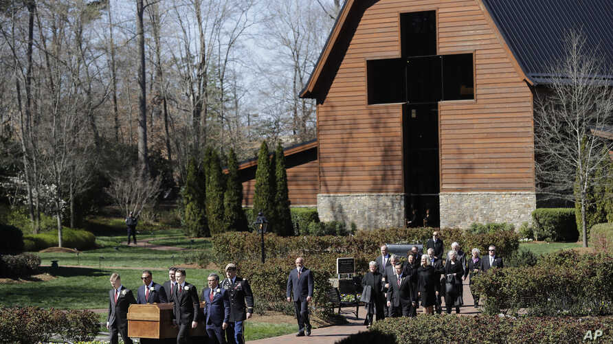 The casket of The Rev. Billy Graham is moved during a funeral service at the Billy Graham Library for the Rev. Billy Graham, who died last week at age 99, in Charlotte, N.C., March 2, 2018.