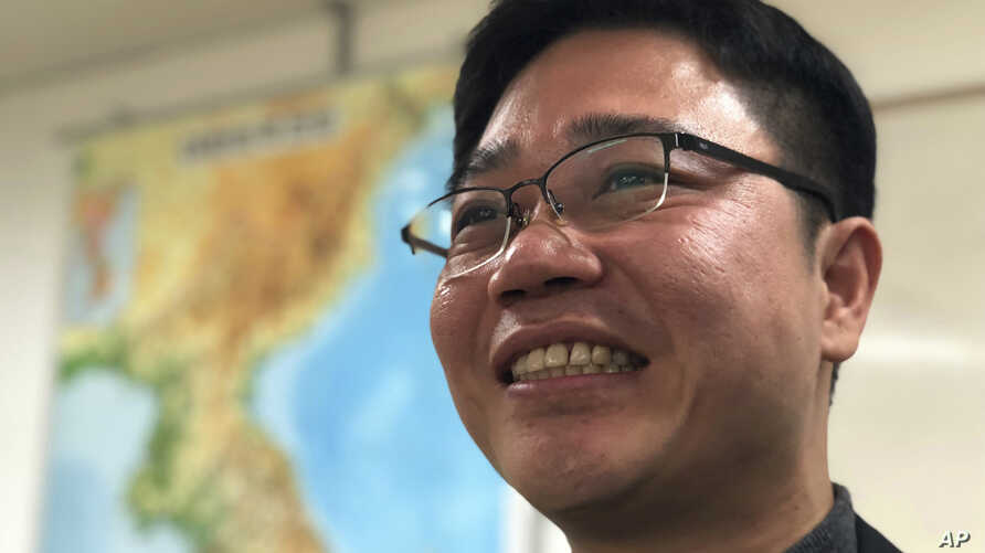 North Korean defector Ji Seong-ho smiles during an interview at his office in Seoul, South Korea, Feb. 13, 2018.