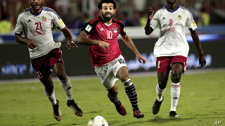 FILE - Egypt's Mohamed Salah, center, battles for the ball with Congo's Delvin N'Dinga, right, and Tobias Badila during the 2018 World Cup group E qualifying soccer match at the Borg El Arab Stadium in Alexandria, Egypt, Oct. 8, 2017.