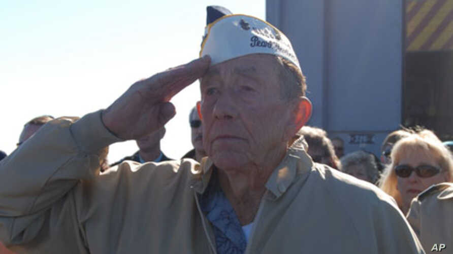 Pearl Harbor survivor Charles Ellis salutes during a Dec. 7, 2008 ceremony marking the anniversary of the attack on Pearl Harbor.