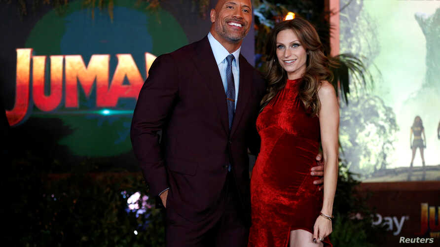 "FILE - Cast member Dwayne Johnson and Lauren Hashian pose at the premiere for ""Jumanji: Welcome to the Jungle"" in Los Angeles, California, U.S., December 11, 2017."