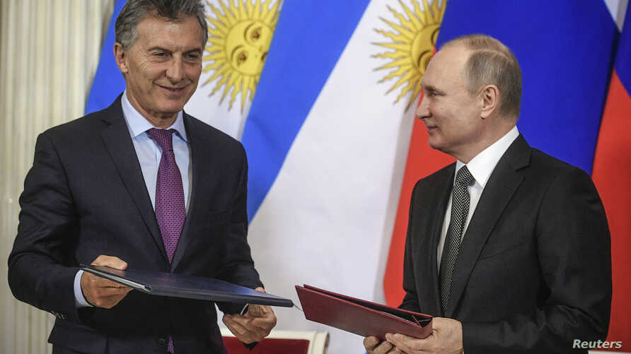 FILE - Russian President Vladimir Putin, right, and his Argentinian counterpart Mauricio Macri attend a signing ceremony following their talks at the Kremlin in Moscow, Russia, Jan. 23, 2018