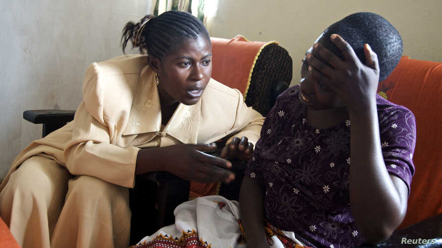 Apollonie, a Congolese counselor, speaks with a rape victim in the HEAL Africa hospital in Goma, (File photo).