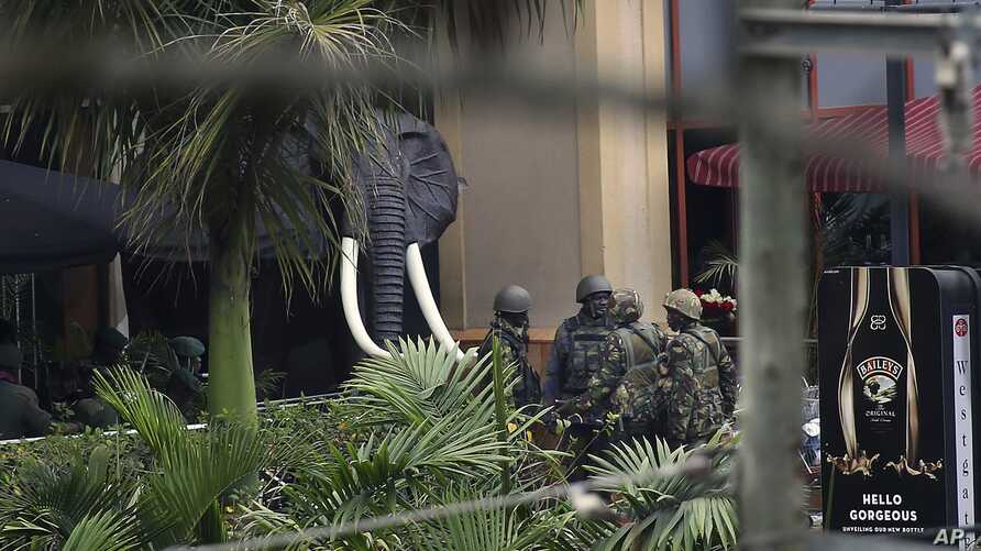 Kenyan security forces are seen at the entrance of the Westgate Mall in Nairobi, Kenya, Sept. 24 2013.