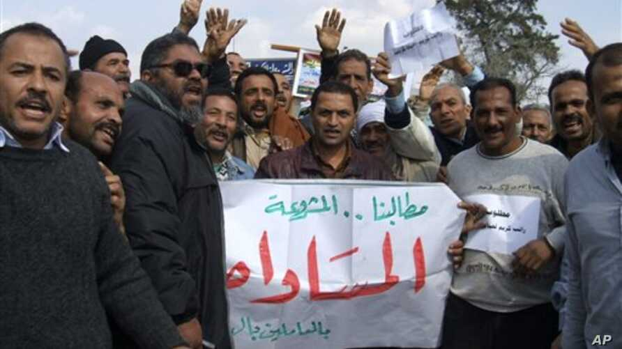 Suez Canal Company workers protest as they began an open-ended strike in front of the company's headquarters in Ismailia City, Egypt,Wednesday, Feb. 9, 2011. The canal stayed open as everal hundred workers demonstrated, demanding the resignation of t