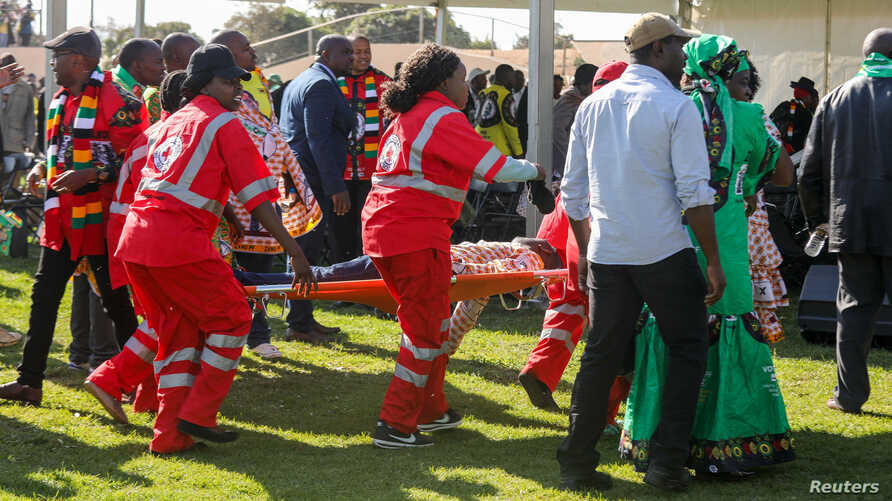 Medics attend to people injured in an explosion during a rally by Zimbabwean President Emmerson Mnangagwa in Bulawayo, Zimbabwe, June 23, 2018.