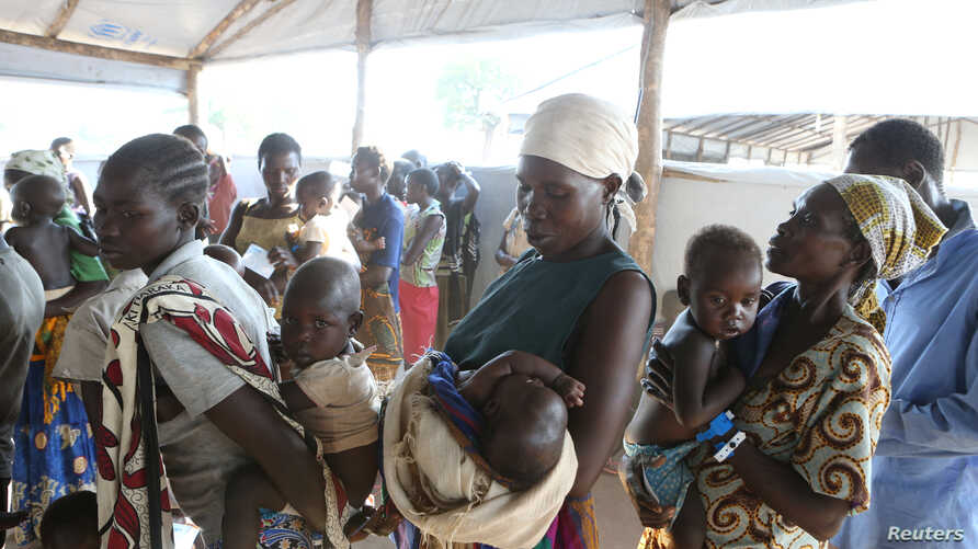 Women who fled fighting in South Sudan wait with their children for the immunization of their children on arrival at Bidi Bidi refugee's resettlement camp near the border with South Sudan, in northern Uganda Dec. 7, 2016.