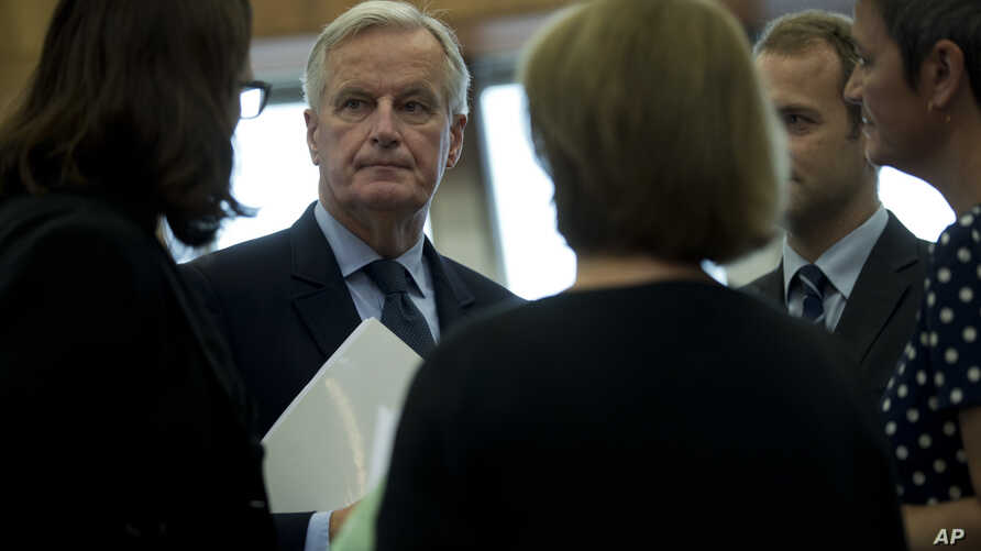 EU chief Brexit negotiator Michel Barnier, second left, talks to other European Commissioners before a weekly meeting at the European Commission headquarters in Brussels, Wednesday, Oct. 10, 2018.