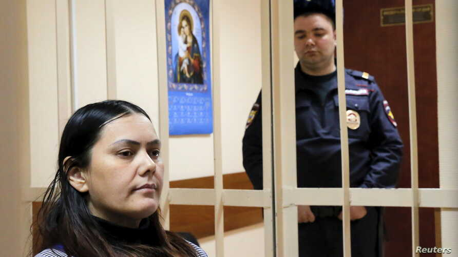 Gulchekhra (Gyulchekhra) Bobokulova, a nanny suspected of murdering a child in her care, sits inside a defendants' cage as she attends a court hearing in Moscow, Russia, March 2, 2016.