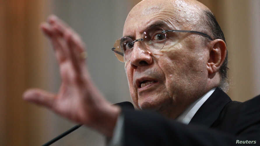 Brazil's Finance Minister Henrique Meirelles gestures during a meeting with businessmen in Porto Alegre, Brazil, March 26, 2018.
