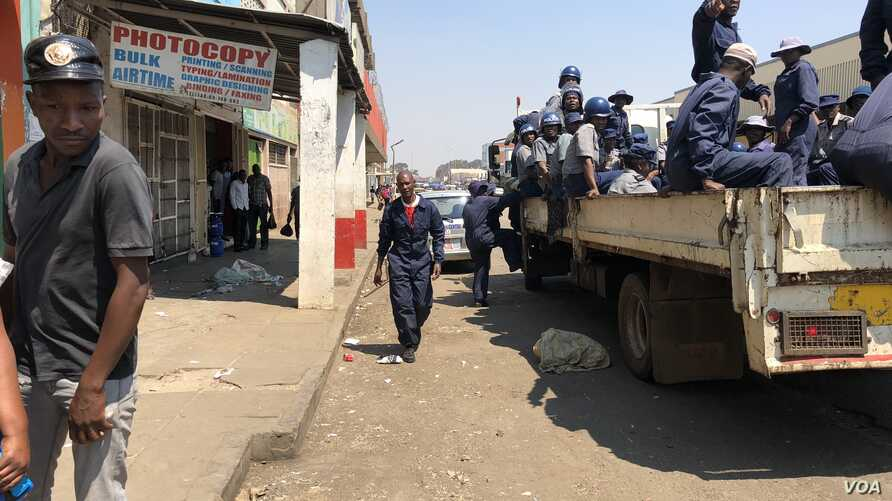 Zimbabwe police was in streets of Harare on Sept. 16,  2018 removing vendors as part of efforts to fight cholera outbreak which has killed more than two dozen people over the past two weeks.